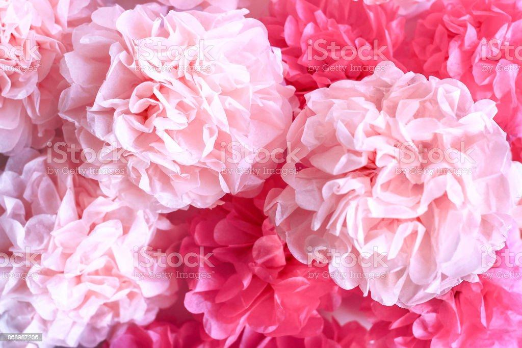 Pink Tissue Paper Pom Poms Background stock photo