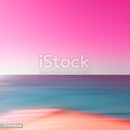 Defocused soft pastel color background image of the sky, ocean and sandy beach