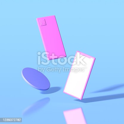 istock Pink toy-style smartphones with a blank screen levitate against a blue background. 3D render. 1239372782