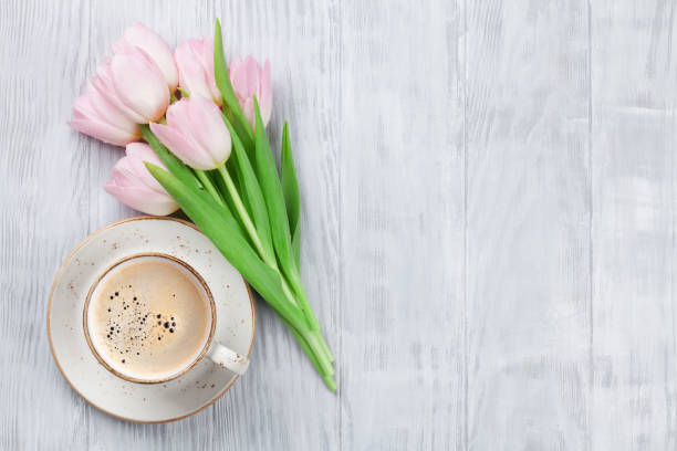 Pink tulips and coffee cup stock photo