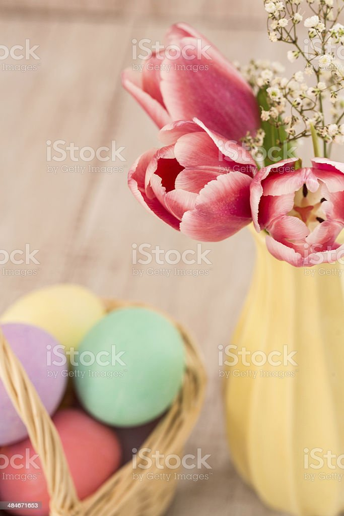 Pink Tulips and Colorful Easter Eggs stock photo