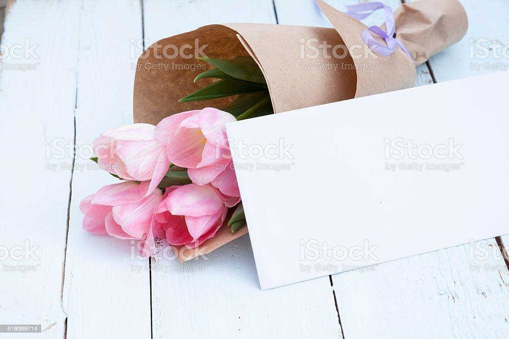 Pink tulips next to a white envelope royalty-free stock photo