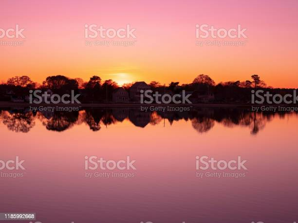 Photo of Pink twilight and setting sun reflected on the East River water in Onset, Massachusetts