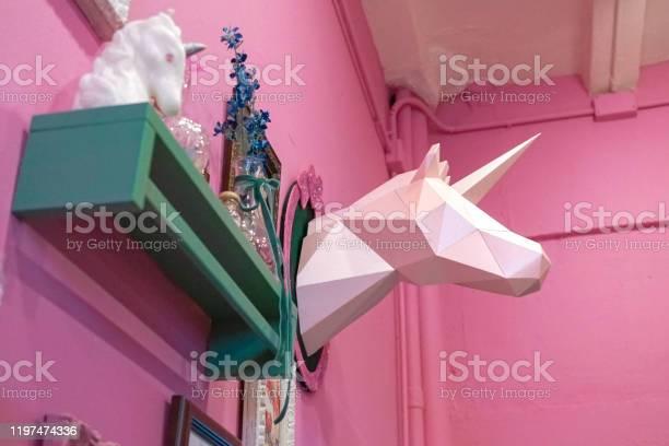 Pink unicorn polygon on a pink wall magical and fantasy interior picture id1197474336?b=1&k=6&m=1197474336&s=612x612&h=gzmb4u1i270cqtxsjf4qdv3scmwjwb1wk8djv onscu=