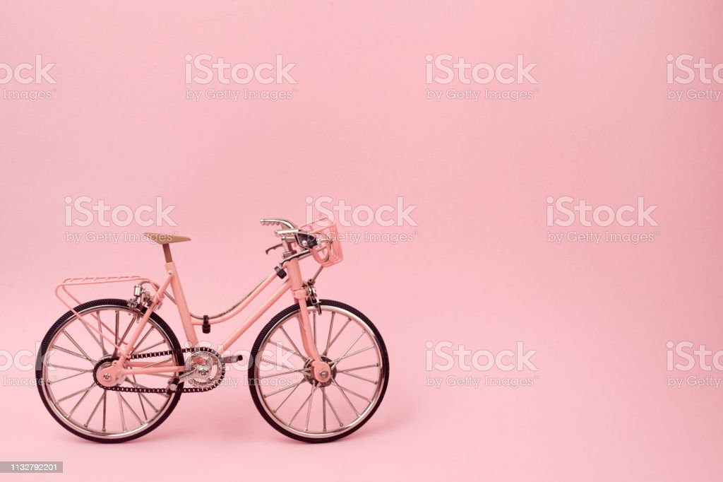 Pink woman bicycle on pink background. pastel minimal style concept.