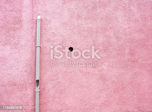 Pink wall and water pipe