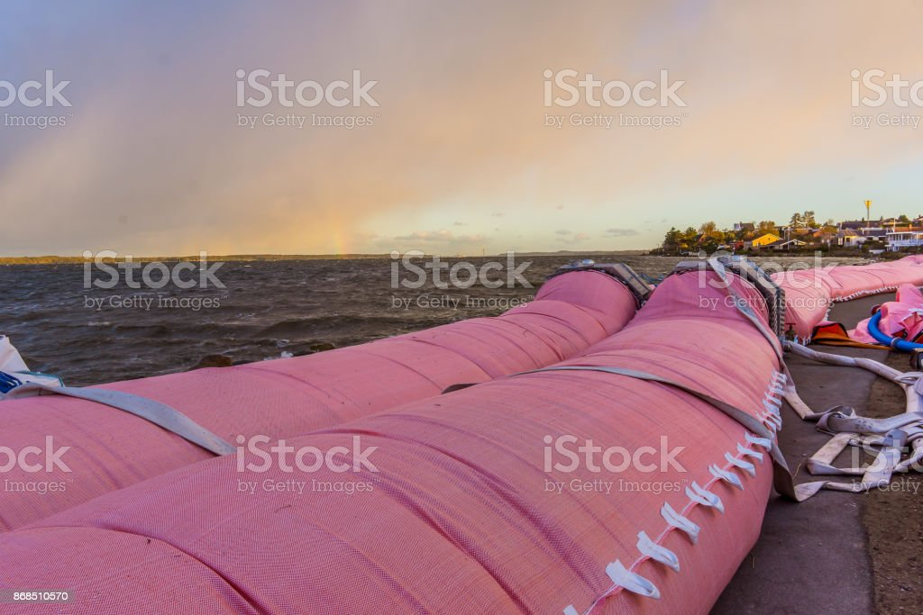 Pink water tube against the flood at Roskilde fjord stock photo