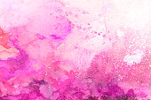 Pink watercolor splatter transparent with layers and splashes on white watercolor paper. My own work.