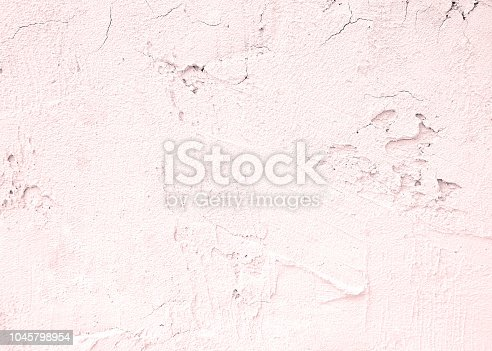 939873258 istock photo Pink white cement texture plastered stucco wall painted fade background. 1045798954