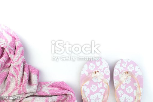 istock Pink with white flowers flip flop sandals beach shoes, beach items isolated on white background. Top view and copy space 973187934