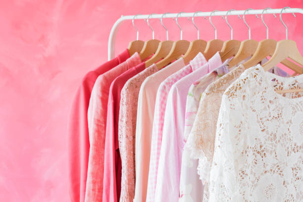 Pink women clothes hanging on rack Pink feminine women clothes hanging on rack blouse stock pictures, royalty-free photos & images