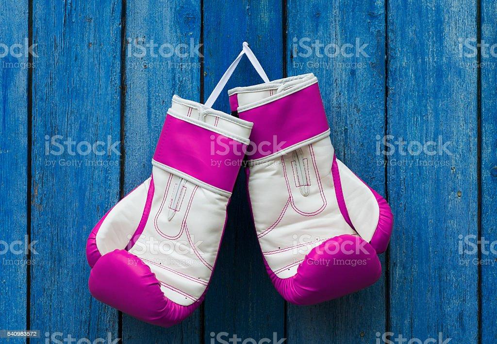 Pink women's gloves stock photo