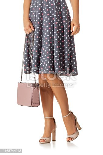 istock pink women's shoes and leather bag. 1165744213