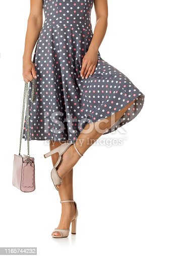 istock pink women's shoes and leather bag. 1165744232