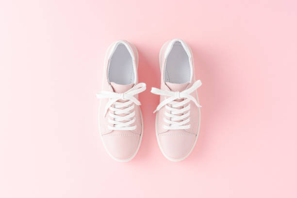Pink women's sneakers on background. Close up stock photo