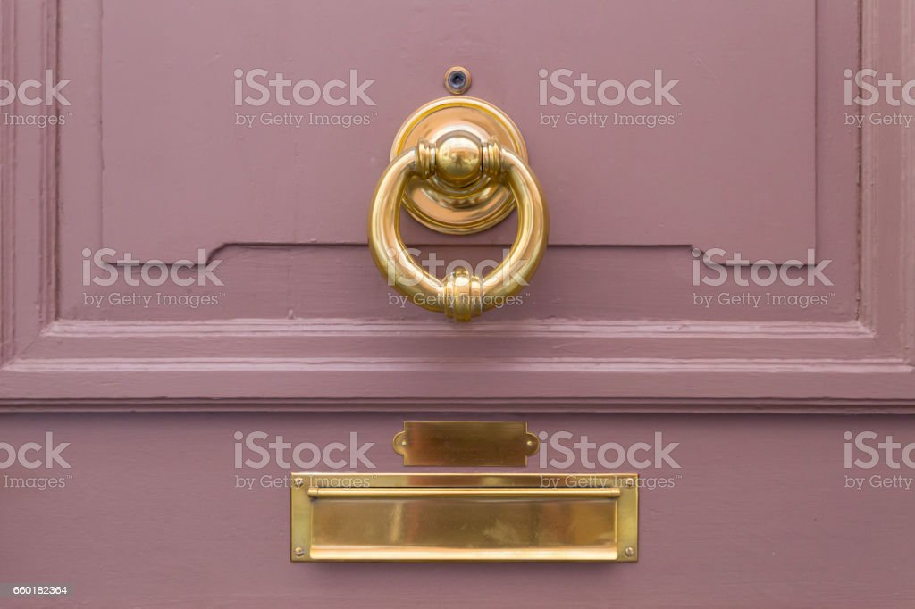 Pink Wooden Door With Golden Ring And Mail Box Stock Photo