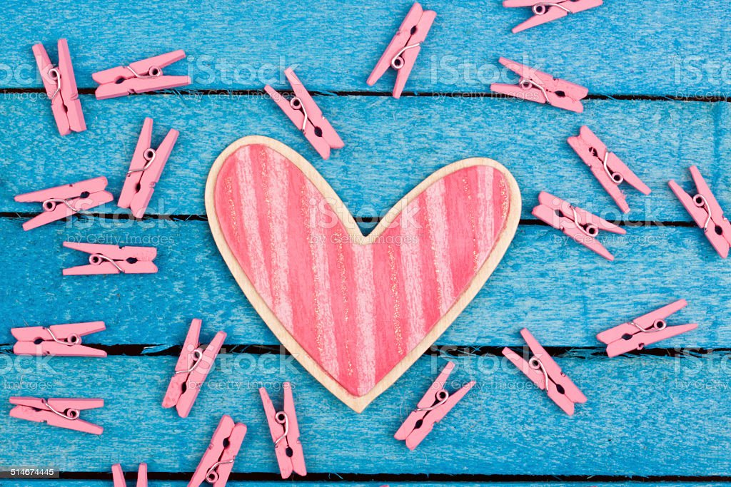 pink wooden heart shape stock photo