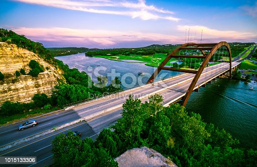 501329818istockphoto Pink Wraps the Sky at Pennybacker Bridge 1015133306