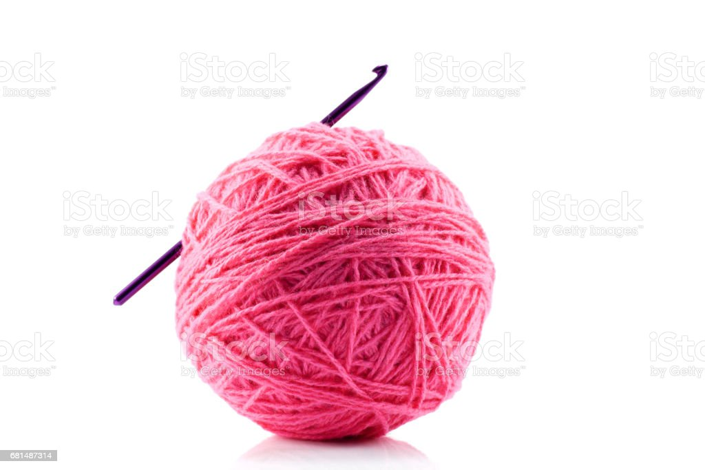 Pink yarn and crotchet hook isolated on white stock photo