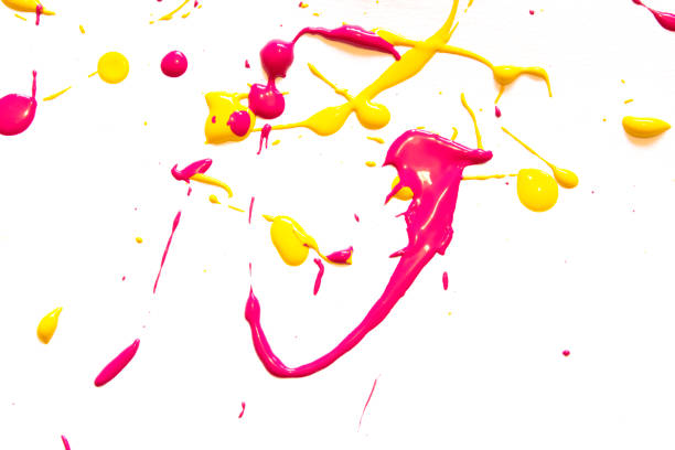 Pink, Yellow and Orange Messy Paint Splatters Background stock photo
