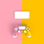 istock Pink yellow joystick with smart phone on pink yellow table background 959100082