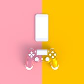 istock Pink yellow joystick with smart phone on pink yellow table background, Computer game competition, Gaming concept, 3D rendering 961247154