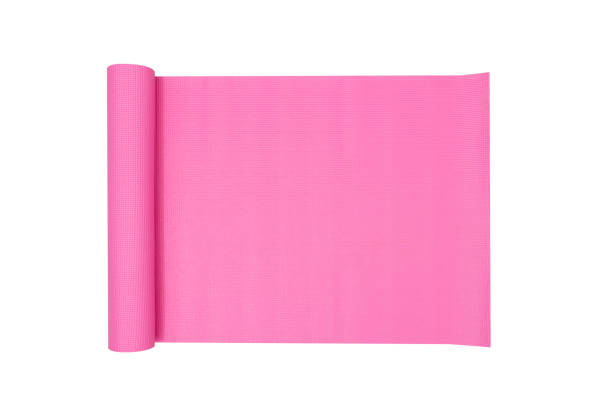 Pink Yoga Mat with White Background stock photo