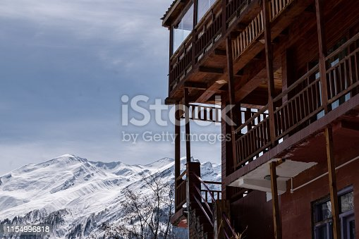 Hotel With Snowcapped Mountain In The Background
