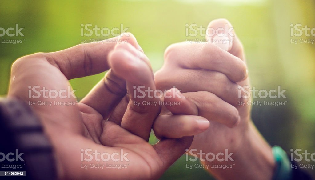 Pinkie Promise stock photo