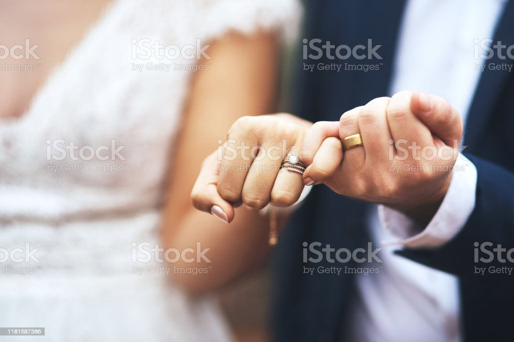 I pinky promise I'll be by your side forever Cropped shot of an unrecognizable newlywed couple doing a pinky swear gesture on their wedding day Adult Stock Photo