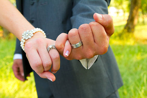 pinky swear wedding rings - pinky promise stock photos and pictures