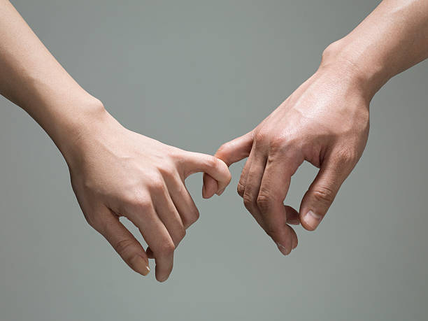 pinky tied. - pinky promise stock photos and pictures