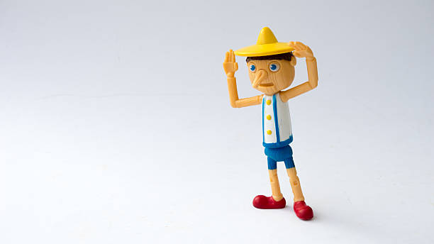 Pinocchio figure from Shrek the movie franchise. Kuala Lumpur, MALAYSIA - April 18, 2015: Pinocchio toy figure from Shrek the movie franchise. Pinocchio is one of Shrek's best friends and is a wooden puppet. pinocchio stock pictures, royalty-free photos & images