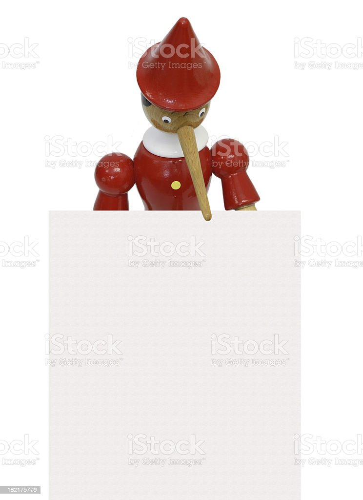 Pinocchio holding sheet of paper royalty-free stock photo