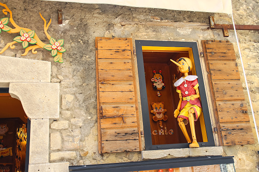 Pinocchio in the window  building store of wooden toys