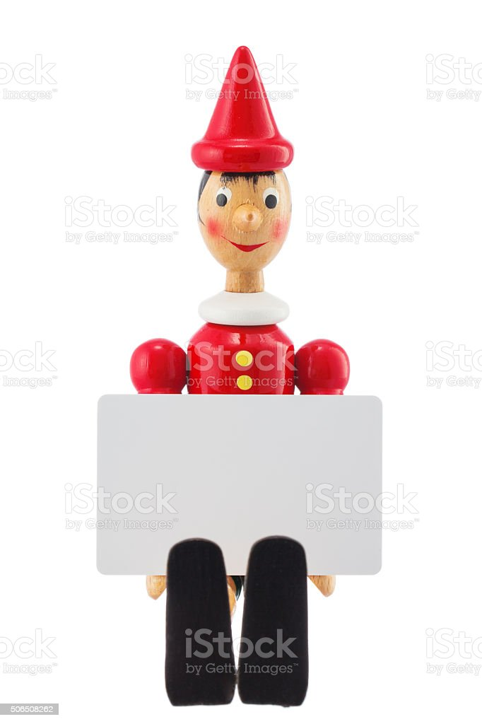 Pinocchio liar toy statue and blank card studio isolated stock photo