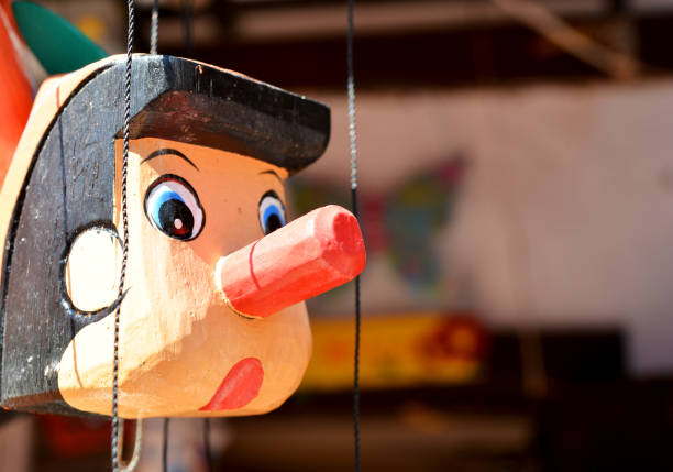 pinocchio wooden mannequin and pinocchio pinocchio stock pictures, royalty-free photos & images