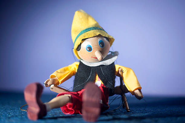 pinocchio Old toy marionette doll pinocchio pinocchio stock pictures, royalty-free photos & images