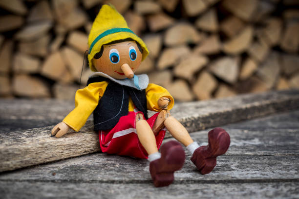 pinocchio Old wooden pinocchio pupett marionette toy Old wooden pinocchio pupett marionette toy pinocchio stock pictures, royalty-free photos & images