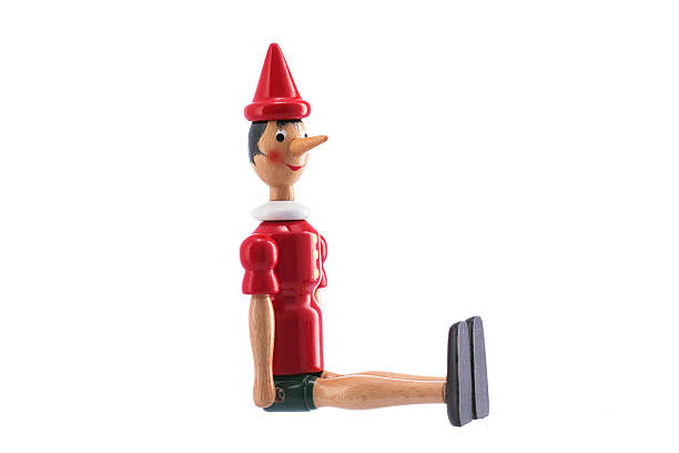 Pinocchio Toy Statue isolated on white Pinocchio Toy Statue isolated on white background pinocchio stock pictures, royalty-free photos & images
