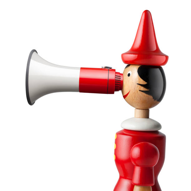 Pinocchio with a megaphone nose on white background stock photo