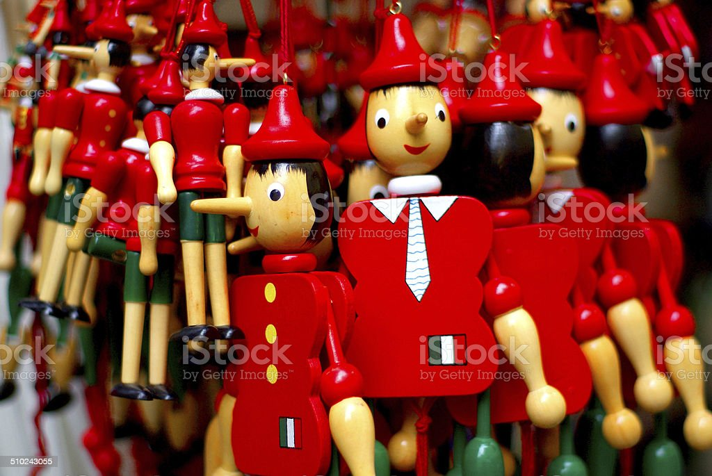Pinocchio_1 Puppet white, red and green goes to the market Art And Craft Stock Photo