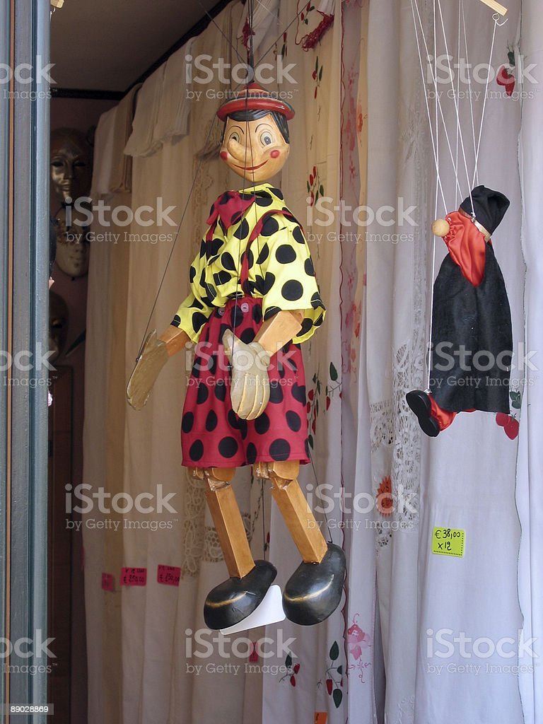 Pinochio puppet hanging in shop doorway royalty-free stock photo