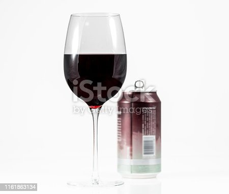 istock Pinot Noir red wine in wine glass with a single serve aluminum can in background 1161863134