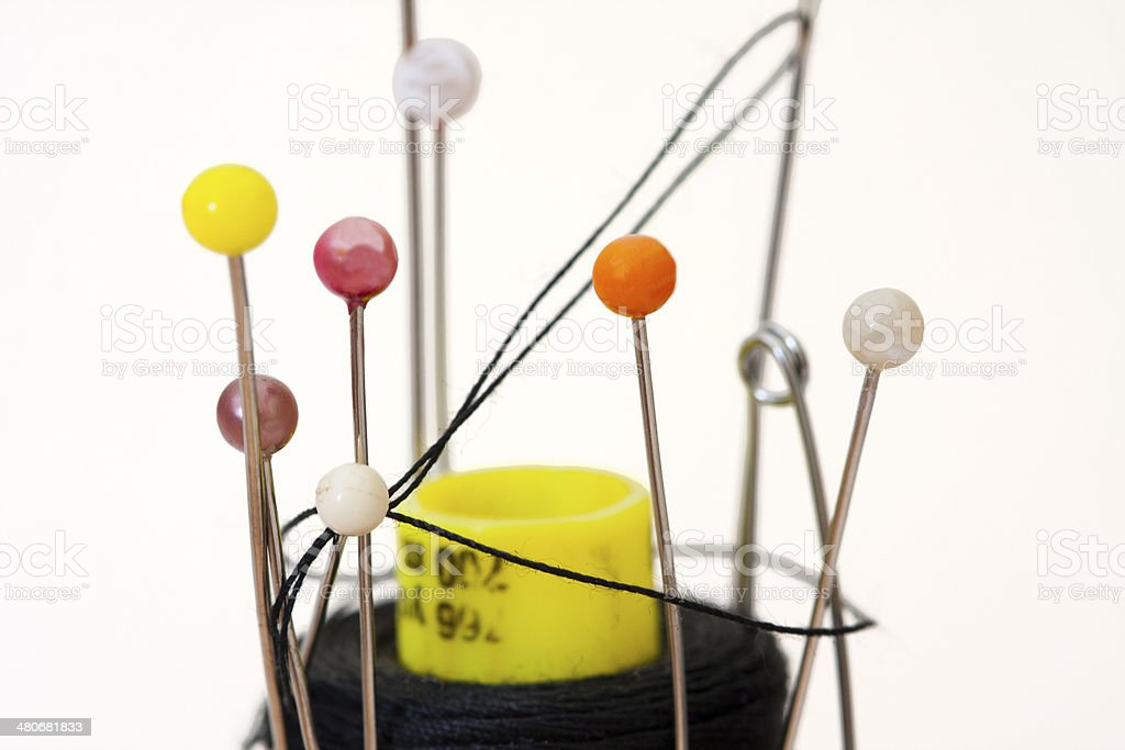 pins and sewing thread stock photo