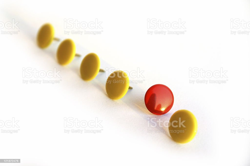 Pins in row - standing out stock photo