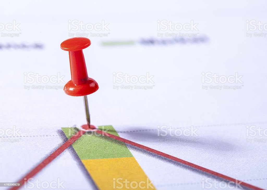Pins on financial chart stock photo