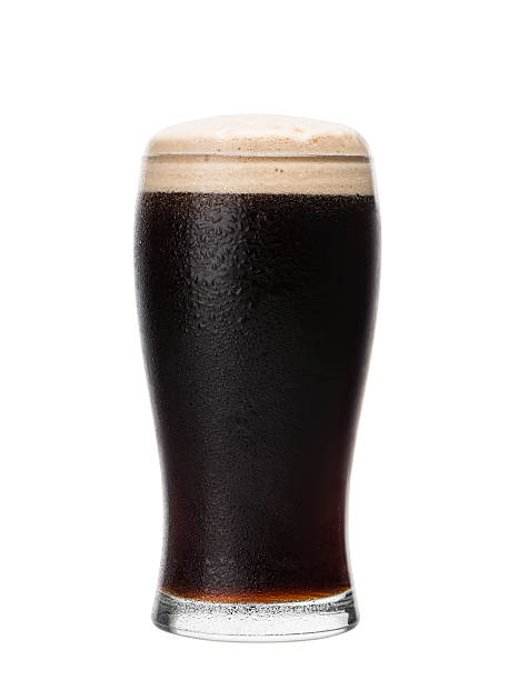 pint glass of dark beer. home brewing. - dark beer stock photos and pictures
