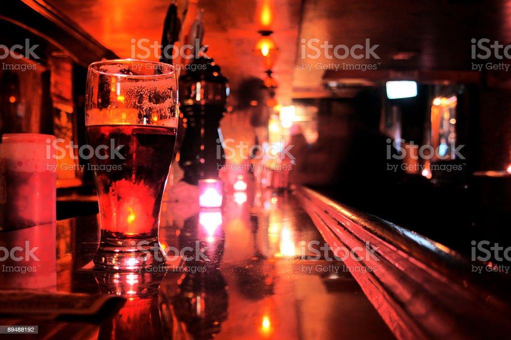 Pint Glass on Bar Top - New York City Dive-Bar royalty-free stock photo