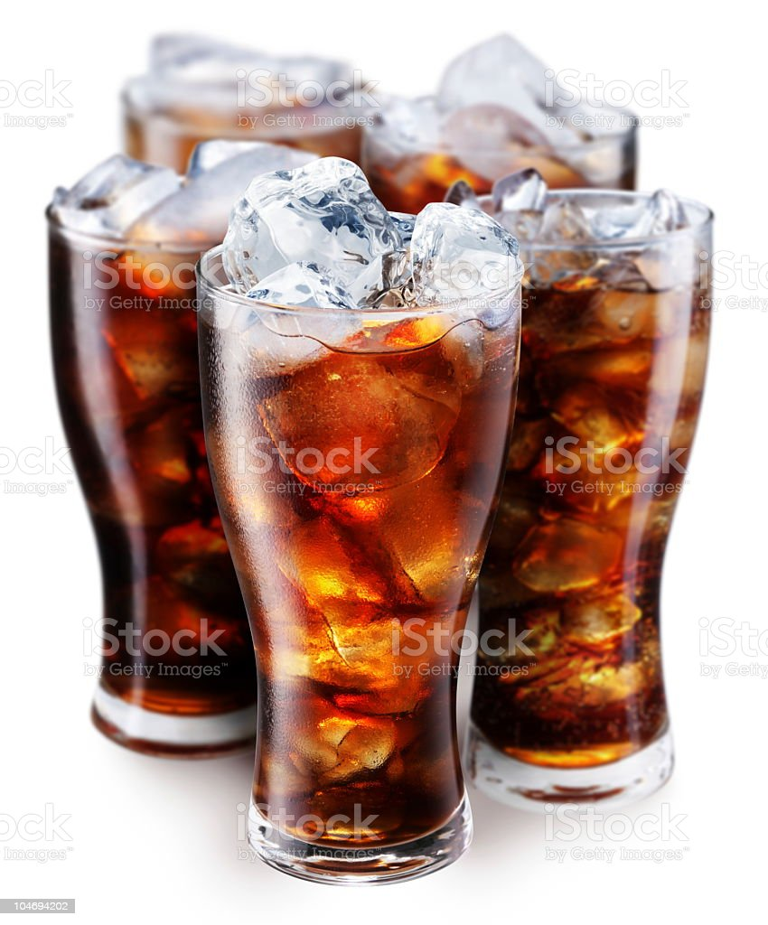Pint glasses full of cola with ice on a white background stock photo